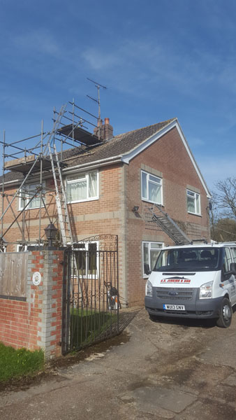 A chimney was taken down and rebuilt and a new flat roof in Janes Lane, Burgess Hill