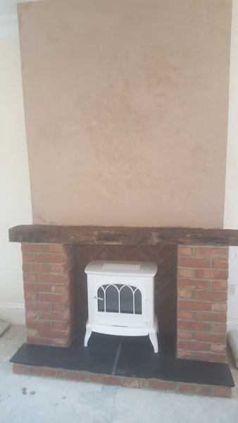A interior wall was taken down and a firepace was built in Park Road, Burgess Hill