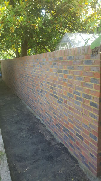 A wall that had gone over to the back of Paynes Bee Farm has been rebuilt