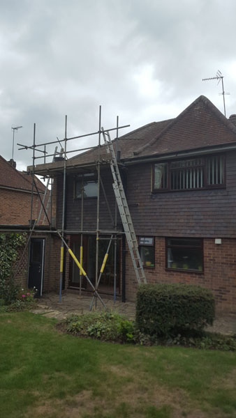 Loose hip tiles taken off and re laid in Greenlands Close, Burgess Hill