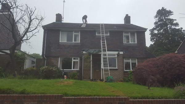 Moss clearance on a roof in Wilmington Close, Hassocks