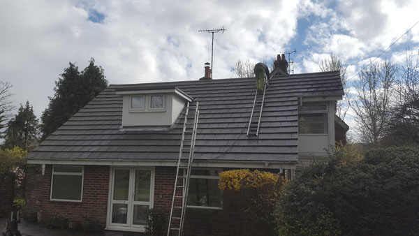 Moss clearance to a roof in Dale Avenue, Hassocks