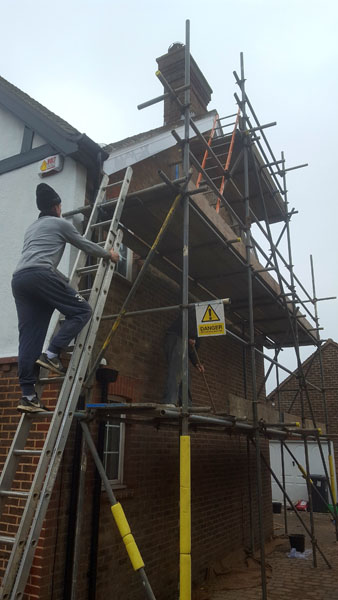 Repointing the end gable of a property in Park Road, Burgess Hill