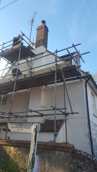 The end gable tiles were taken off and re laid in East End Lane, Ditchling