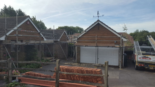 The old timber cladding was taken off and then felt, battened and tiled in. northbank, Hassocks