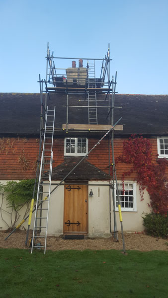 We hacked off the defective render and re rendered the chimney. Spatham Lane, Ditchling
